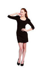 Pretty teenage girl in black dress posing against a white backgr