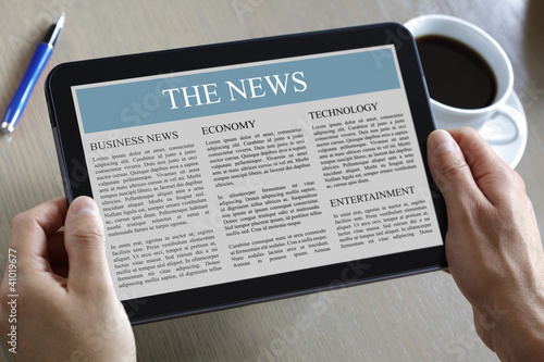 Digital tablet showing news