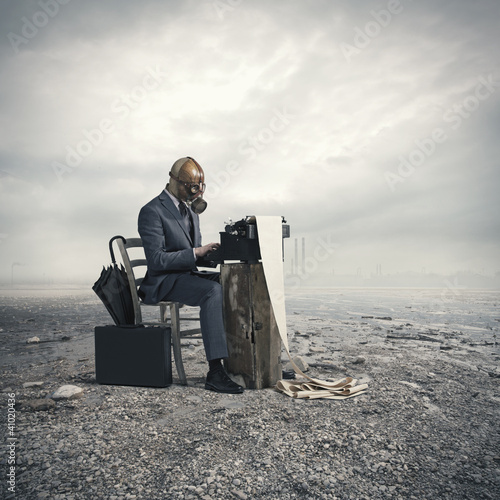business wearing a gas mask, write with an old typewriter