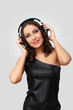 Young woman in evening dress with headphones