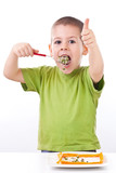 Boy eating healthy salad