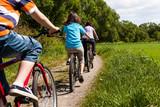 Fototapety Family riding bikes