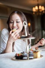 Attractive Asian Female Tasting Dessert