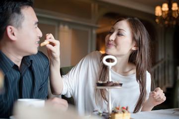 Attractive Asian Couple feeding man