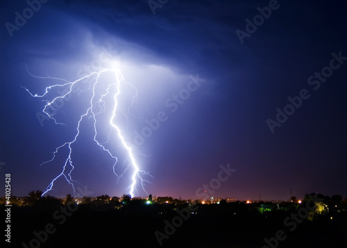 Foto op Canvas Onweer Lightning over small town