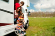 Family vacation in camping. Travel on motorhome with kids