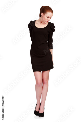 Pretty teenage girl in a small black dress