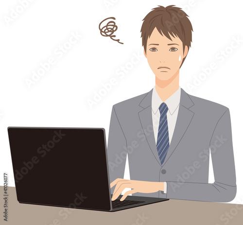 男性とパソコン