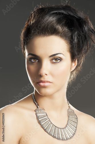 the girl with silver necklace, she is in front of the camera