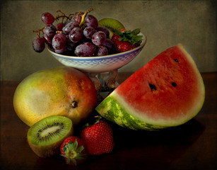 Still life, grapes, mango, kiwi, strawberries and watermelon