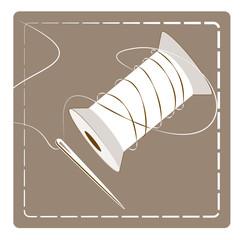 bobine de fil et aiguille
