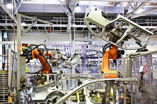 Leinwanddruck Bild robots in a car factory