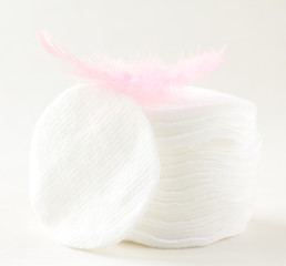 cotton cosmetic disks sponges with a pink feather