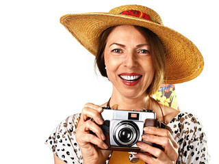 smiling woman with old analog camera