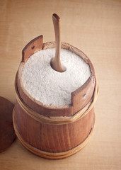 flour in a small wooden barrel
