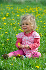 little girl in the spring meadow