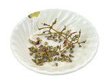 Bowl with discarded grape seeds and stems poster