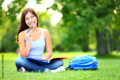 Student thinking looking in park