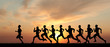 canvas print picture - Marathon, black silhouettes of runners on the sunset