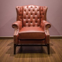 Front of Classic Chesterfield luxury Brown Leather armchair