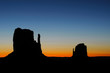Sunrise behind the Mittens at Monument Valley