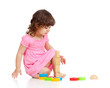 Funny little child playing with colorful toys, isolated over whi