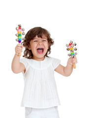 emotional child playing with musical toy