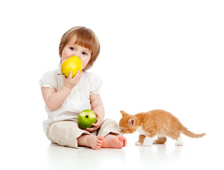 child with kitten and healthy food apples