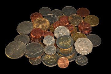 Coins on the black background