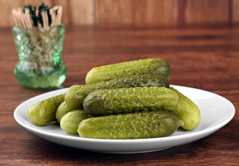 Dill Pickles on a plate, close up.