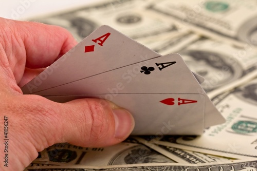 people show three ace on a money background