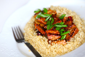 Sweet and sour tofu with quinoa and scallions