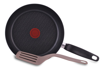 New empty frying pan and spatula