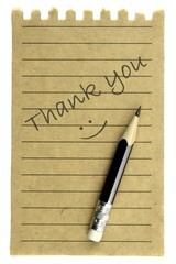 "Handwriting "" Thank you "" on a natural note paper"