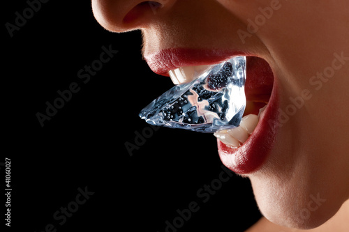 Ice cube in woman's mouth.