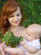 beautiful mother with a baby in a garden