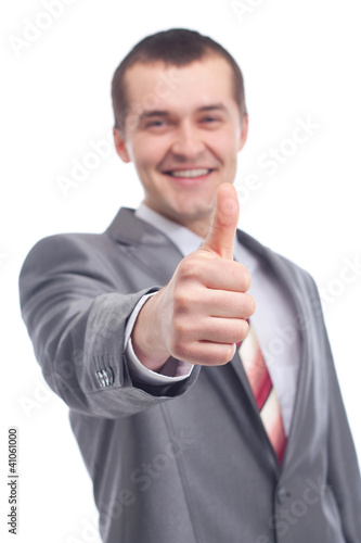 Smiling young business man thumbs up