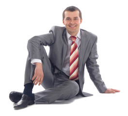 Portrait of business man sitting on the floor
