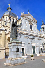 Statue of pope John Paul II  in front of Almudena Cathedral