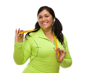 Hispanic Woman In Workout Clothes with Tape Measure