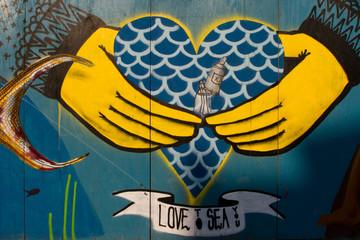 Street art on the wall in Brooklyn heart