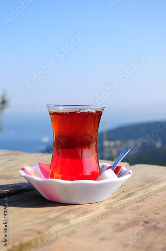 a glass of black (red) tea  on table