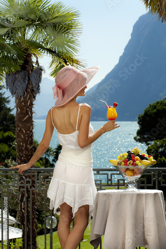 portrait of beautiful woman on the terrace, back view