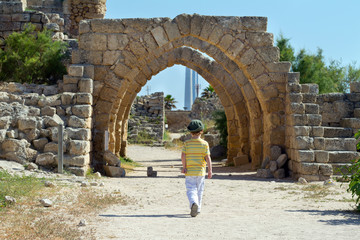 Little boy walks in Caesarea. Israel