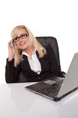 Businesswoman in glasses working