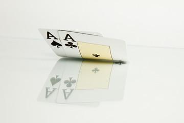 Pocket aces cards casino over glass