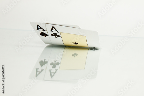 Pocket aces cards casino over glass