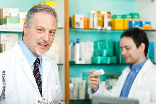 Portrait of pharmacists in a store