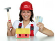 Pretty girl with money, helmet and hammer for building a house