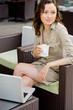 Modern pretty woman having breakfast or lunch at sidewalk cafe